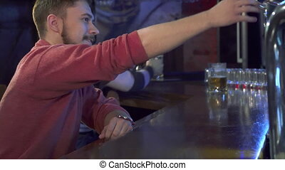 Man tastes beer at the pub