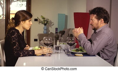 Man telling wife about debts