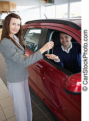 Man tending his hand while receiving car keys