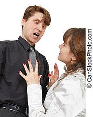 Man terribly shouts at young woman - The man terribly shouts...