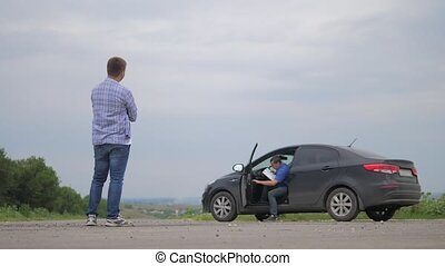 man test drive car.two men make deal. man seller driver...