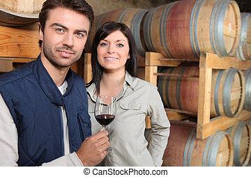 Man testing wine cellar