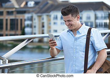 Man Texting On Mobile Phone On Way To Work