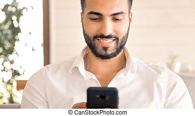 Man Texts Message - Fit attractive man in pristine white...