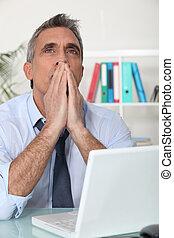 Man thinking at his computer