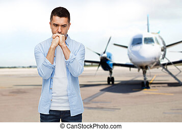 man thinking over airplane on runway background