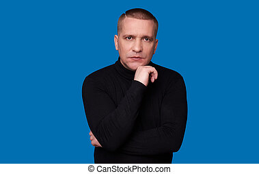 man thinking over blue background