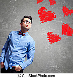man thinks at love - young business man looking up at some...