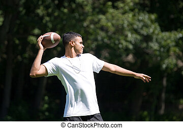 Man Throwing a Football