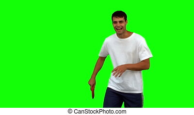 Man throwing a frisbee on green screen