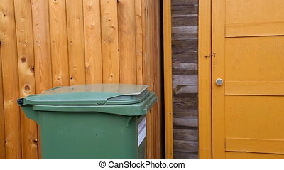 Man throwing garbage into litter-box in outside and leaving....