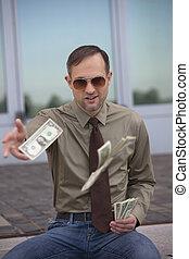 man throwing the money