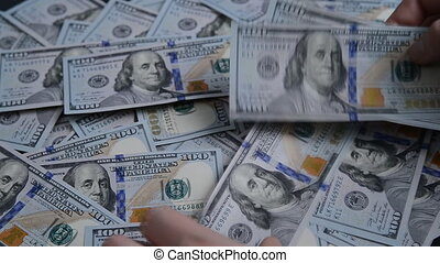 Man throws on the table 100 dollar bills.