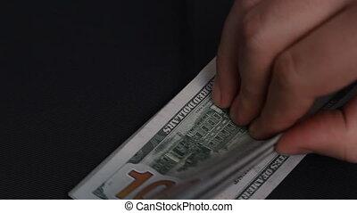 Man throws on the table 100 dollar bills. - 100 dollar bills...