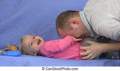 Man tickle and small child girl laugh.