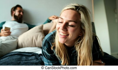 Man tickling woman while lying on bed 4k - Man tickling...