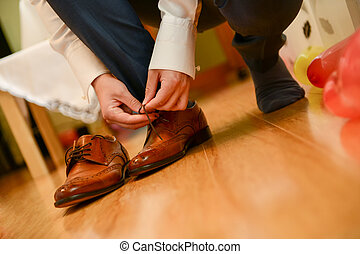 Man tied shoelace in natural light