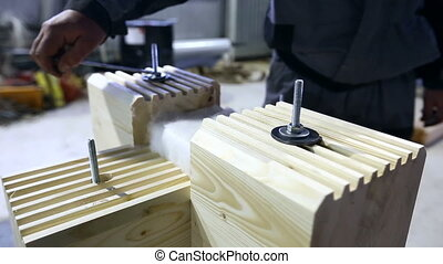Man tightens fasteners with wrench on profiled bar - Worker...