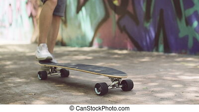 Man tipping up his skateboard with his foot