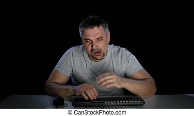 Man tired effort on keyboard keys. Emotions. Studio - Man...