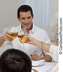 Man toasting with his mother in a Christmas dinner