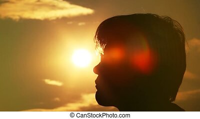 man touches the sun and sky by the face