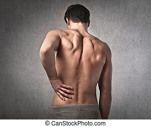 Man touching his back