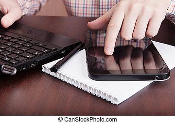 Man touching on digital tablet PC