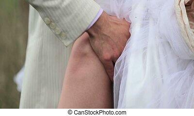 Man touching woman's leg closeup