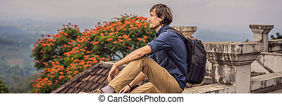 Man tourist in abandoned and mysterious hotel in Bedugul. ...