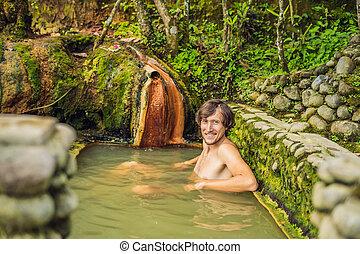 Man tourist in Belulang Hot Springs in Bali, Village ...