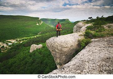 Man tourist in mountain