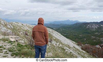 Man tourist on the mountain. Lovcen, Montenegro, Adriatic