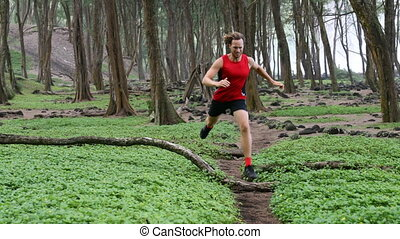 Man Trail Running - Determined Male Runner Athlete Jogging In Forest