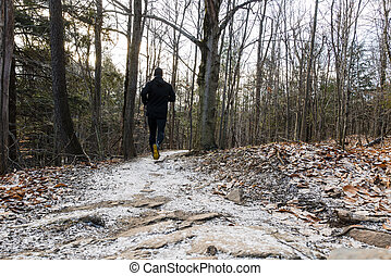 Man trail running in the snow
