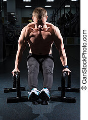 Man training abdominal muscles in the fitness room