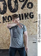 Man training in a garage
