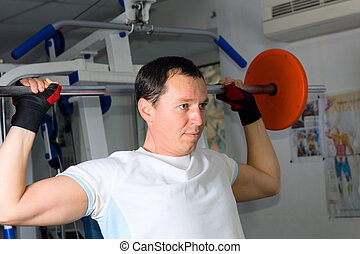Man training in fitness center
