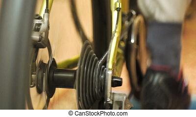 Man training on sport machine in fitness club - Man feet...