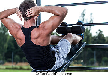 Man training on the outdoor gym