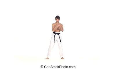 Man training taekwondo or karate Isolated on white - Man...