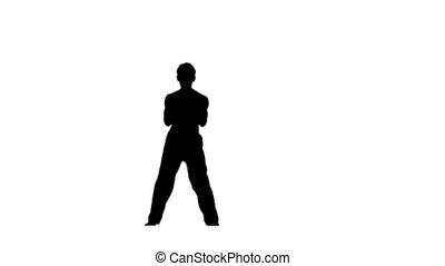 Man training taekwondo or karate, Silhouette, Slow motion -...