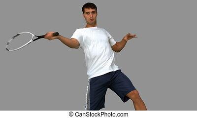 Man training while playing tennis
