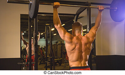 Man training with barbell in the gym