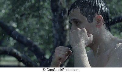 Man trains at the rain
