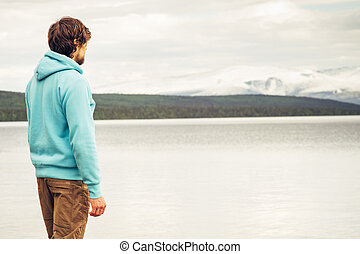 Man Traveler alone outdoor Lifestyle Travel concept...