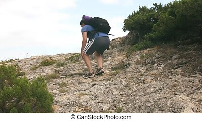 Man traveler feel knee ache - While hiking man injuring his...
