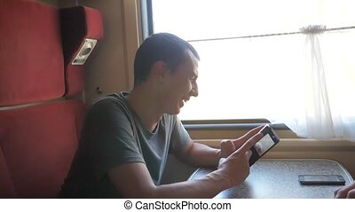 man traveler Relaxing On Train Listening To Music and...