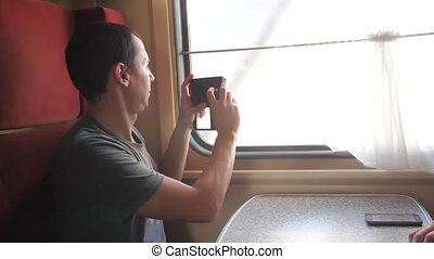 man traveler taking pictures on a smartphone and smiling...