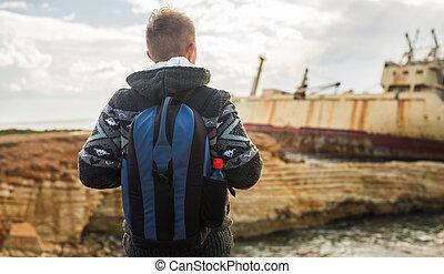 Man traveler with backpack enjoying the natural surroundings.